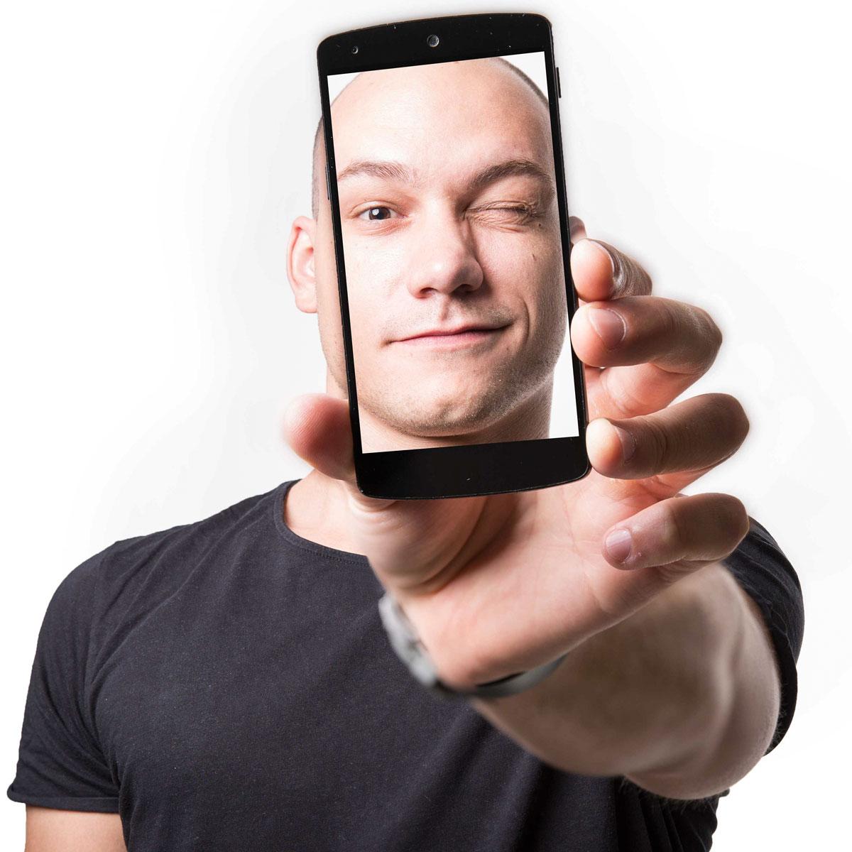 Imagefotografie von Mitarbeiter mit Handy